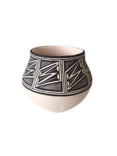 This Acoma-style pottery is by my favorite Acoma artist. I own many pieces of her work and have followed her for years. She doesn't make many pieces because each on takes so long to make. She collects