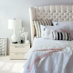 I miss a headboard. This one makes a statement. That can only be punctuated with a sleek chandelier