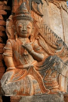 Detail of a guardian Nat (spirit) at one of the many small shrines at Shwe Inn Thein, Myanmar