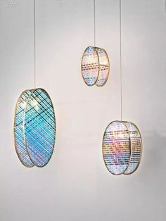 Woven Glass pendant fixtures in colored-glass and unpolished brass by Gustav van Treeck. Woven Glass pendant fixtures in colored-glass and unpolished brass by Gustav van Treeck.
