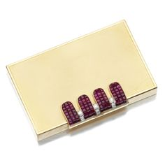 YELLOW GOLD, RUBY AND DIAMOND VANITY CASE, VAN CLEEF & ARPELS, 1940S. The rectangular case to a hinged clasp set en serti mystérieux with calibré-cut rubies and square-cut diamonds, opening to reveal a mirror, powder compartment and lipstick, mounted in yellow gold, measurements approximately 82mm x 50mm x 10mm, signed Van Cleef & Arpels and numbered, French assay and maker's marks.