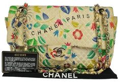 Chanel Camellia Quilted Cc Double Chain Nylon Shoulder Bag. Get one of the hottest styles of the season! The Chanel Camellia Quilted Cc Double Chain Nylon Shoulder Bag is a top 10 member favorite on Tradesy. Save on yours before they're sold out!
