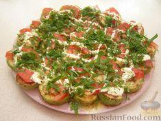 Фото к рецепту: Закуска из кабачков с чесноком и помидорами