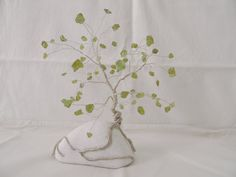 Peridot gemstone wire tree by AbssOluto on Etsy White Pebbles, Wire Trees, Handmade Wire, Heart Chakra, Wire Jewelry, Peridot, Crystal Healing, Gemstones, Crystals