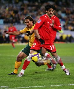Nick Carle of the Socceroos and Husain Mohamed of the Bahrain of Bahrain compete for the ball during the 2010 FIFA World Cup Asian qualifying match...