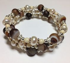 Artful Evidence - 8mm Brown Striped Agate, 7-8mm Ivory White Rondelle Fresh Water Pearls, 4mm Ivory Cream Czech Glass Druk Beads, Silver Plated Spacer Beads.