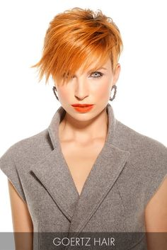 Stay cool this summer with this fiery copper short cut that features lengthy bangs that graze the cheekbones for a striking effect.