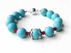 I have created this large gemstone powder blue Turquoise Howlite and Red Coral bracelet using softflex beading wire and a magnetic clasp for an easy on and easy off stylish bracelet. The powder blue stones have beautiful veining, each one unique.    Tiny genuine red coral beads are used to enhance the look along with beautiful silver plated bead caps. A silver plated strong magnetic clasp finishes the look, giving the bracelet a no fuss, easy on and easy off feature.   I love the baby blue…