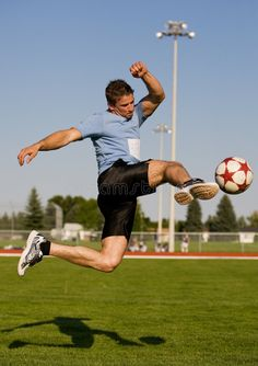 Photo about Athletic male in the air kicking a soccer ball. Image of shoe, grass, teamwork - 6140115 Action Pose Reference, Human Poses Reference, Pose Reference Photo, Poses Dynamiques, Cool Poses, Gesture Drawing Poses, Drawing Tips, Soccer Poses, Figure Drawing Models