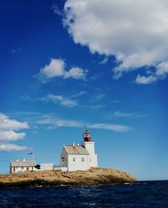 lighthouse, sea, built structure, sky, building exterior, architecture, cloud - sky, water, protection, safety, direction, guidance, tranquility, waterfront, day, scenics, no people, nature, outdoors, beach, nautical vessel, horizon over water, beauty in nature