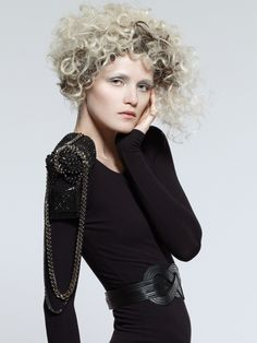 platinum blonde with dark brown lowlights, curly rounded shape cut