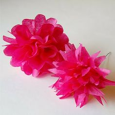This is the perfect easy to make and inexpensive way to detail a wedding. I am thinking of string up a garland of these tissue flowers in coordinating colors for the reception, as well as adding some large single ones to the aisle.
