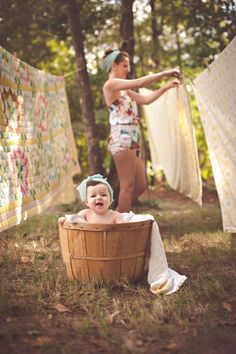 Clothes on the line; baby in the basket.