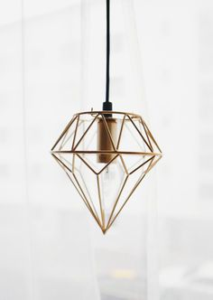 Diamond-shaped metal hanging lamp | Would look amazing above a terrarium display