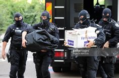 http://media.gettyimages.com/photos/police-officers-of-the-gipn-carry-boxes-and-bags-containing-drugs-picture-id119486897