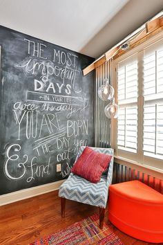 Cozy reading nook in the bedroom with a chalkboard wall [Design: Simply Unique Finds]