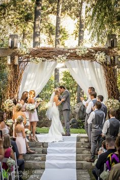 wedding, wedding photography, bride, groom, first kiss, calamigos ranch, ceremony arbor, malibu