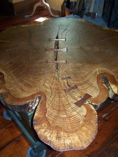 "50"" diameter double trunk butterflied end grain white oak tree table"