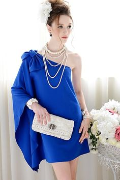 Dress crafted in polyester, featuring one sleeve with bow-knot to shoulder, slim fit, in mini length cut.$85