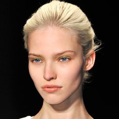Altuzarra Trend: A natural, loose chignon. The key to an undone chignon = texture. Hair done with a texturizing spray, then pulled into a large soft bun. Several pins were used to tuck it into place, letting flyways and pieces hang loosely.
