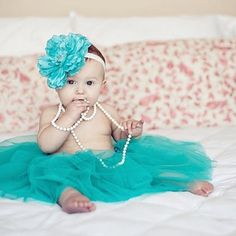 a turquoise blue tutu, a flower and pearls = a fashionista little girl!