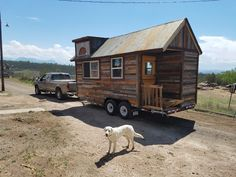 A 160 sq ft tiny house made from reclaimed barn wood. Currently available for sale at $26,000.