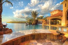 This sweeping vista is the pure definition of paradise. Overlooking the Windsor Lakes in Houston, Texas, this resort-like home features an infinity pool with a 20-foot swim-up bar. Stone Mason of Spring, Montgomery, Texas. Photography by John Guild http://www.luxurypools.com/builders-designers/stone-mason-of-spring.aspx