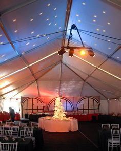 At this Polar Express themed holiday party, we transformed the main tent into an old fashioned dining car with cherry red velvet drapes, holiday linen, a train depot backdrop, and specialty lighting creating a winter night sky.