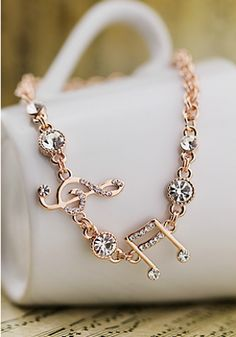 Need this. -Elegant Austria Rhinestones Notes Bracelets                                                                                                                                                                                 More