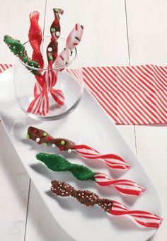 Dip Wilton's Peppermint Twist Sticks into melted Candy Melts® candy; tap stick lightly to smooth surface. Immediately add sprinkles. Set on prepared cookie sheet; chill until set, 5-10 minutes.