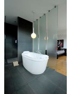 contemporary bathroom by LineBox Studio  Glass panels separate Master bedroom from bath