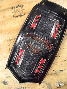 """Black & Red, Multi-layered, carved & tooled leather, """"Man o Steel"""" with acrylic mirror insert! Tooled Leather, Leather Tooling, E Biker, Acrylic Mirror, Leather Projects, Custom Leather, Motorcycle Accessories, Cool, Bibs"""