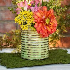Add a splash of spring green to your garden parties, home decor or barn weddings with our 5.25 inch tall tin vase. The horizontal corrugated edges have a patina finish over a light lime green color.