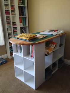 Cutting table - Target & IKEA.  I would use bookshelves instead of cubicles.  They would accommodate the size of my plastic bins better.