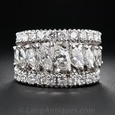 """Platinum Triple Diamond Band. Five-and-a-half carats of bright-white, sparkling marquise and round brilliant-cut diamonds are set in three graduating platinum eternity bands and gently attached so that they stay in place and seem to """"float"""" next to one another on the hand."""