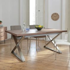 The cross base of this table adds a little something special as it contrasts with the walnut top. Seating 6 comfortably, it will be a great table for a statement dining room. The table easily extends, thanks to an internal stored mechanism so it can accommodate 10 easily within a couple of seconds.