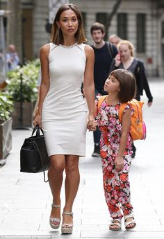 White hot: Myleene, 37, showed the true extent of her fit figure by slipping into a form-flattering white dress which reached to just above her knee