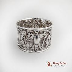 Antique sterling silver napkin ring with Sheffield Moveable Feast scenes, maker's mark HF, 1905.
