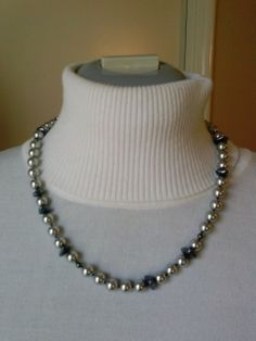 "Item #S3010 20"" knotted glass pearl, hematite, with silver spring ring clasp. $30."