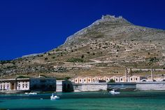 Favignana, Sicily  View from port of Mt Santa Caterina 314m, and the abandoned tuna processing plant Tonnaro Florio in Favignana.