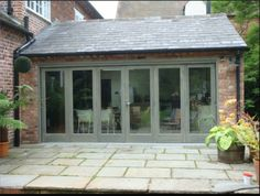 Enclosed patio windows ideas for 2019 Chalet Extension, Extension Veranda, Cottage Extension, Rear Extension, Bifold Doors Extension, Brick Extension, Extension Ideas, Garden Room Extensions, House Extensions
