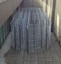 Full scale labyrinth installation by Robert Morris. Installation View: courtyard at Sonnabend Gallery.