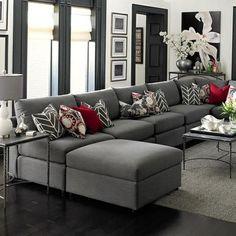 elegantes wohnzimmer grau rote dekokissen bild blume