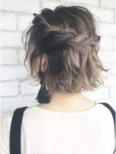 Loose, half-up braid in short hair. This could also be a good way to pull back bangs.