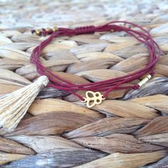 Handmade five cord charm bracelet with sterling silver gold plated butterfly charm and beads and silk tassel by OutOfTheCageCrafts