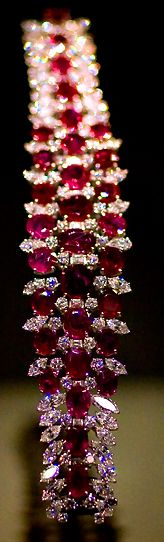 The rubies are a symbol of one thing that Gatsby told Nick about his time after the war. This was a debatable rumor because of the lack of proof.