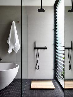 Grey black & white bathroom with Agape bath and accessories