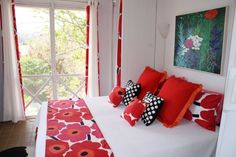 """Beachside """"Poppy Room"""" in St. John, Girls bedroom redo. Played off of colors in painting, using existing Marimekko sheets fashioned into accent pillows to create pops of color,adding Crate and Barrel patent leather look dotted pillows and a black and white cowhide throw rug for playful accents. Indoor/outdoor window treatments with grommets are bordered in Marimekko fabric to complete the look., Girls """"Poppy"""" Bedroom   , Bedrooms Design"""