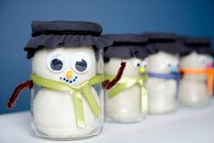 Snowman Playdough Jars are too cute- use them as birthday party favors or small gifts for friends. This tutorial includes the recipe for the play dough and the tutorial for the jar!