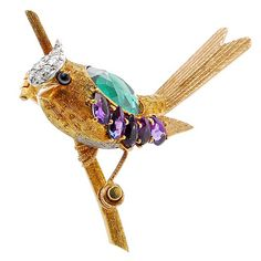 Tiffany & Co. Schlumberger Gem Set Bird Brooch. A Charming bird brooch brightly colored with gems by Jean Schlumberger for Tiffany & Co. The fantastical bird with a 18k gold torso set with an oval green tourmaline and 5 oval amethysts, with a platinum swirled plume on the crown pave-set with diamonds, with a platinum belly, and with an agate eye. All meticulously hand-textured including a branch. [What I do for History's sake!]